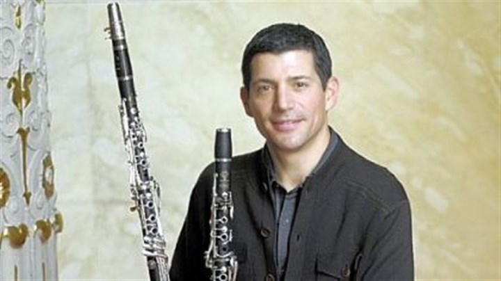 PSO concert review Michael Rusinek == Spectacular performance of Mozart on the obscure basset clarinet, which is the longer of the two clarinets he is holding.