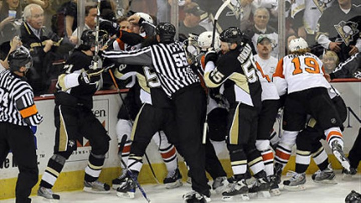 Pushing and shoving Referees separate Penguins and Flyers payers at the end of the first period.