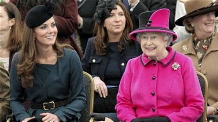 Queen Elizabeth II, right, and Catherine, Duchess of Cambridge Britain's Queen Elizabeth II, right, and Catherine, Duchess of Cambridge, watch a fashion show at De Montfort University in Leicester, England. When it comes to fashion, Queen Elizabeth II is the defining image of royalty.