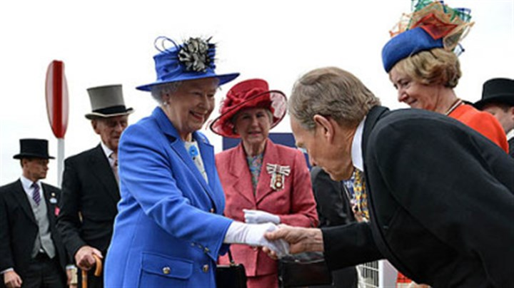 Queen Elizabeth II Queen Elizabeth II shakes hands with a racegoer as Prince Philip, Duke of Edinburgh, second left, and Lord Lieutenant of Surrey Sarah Goad, center behind, follow at the Epsom Derby in Epsom, England on Saturday.