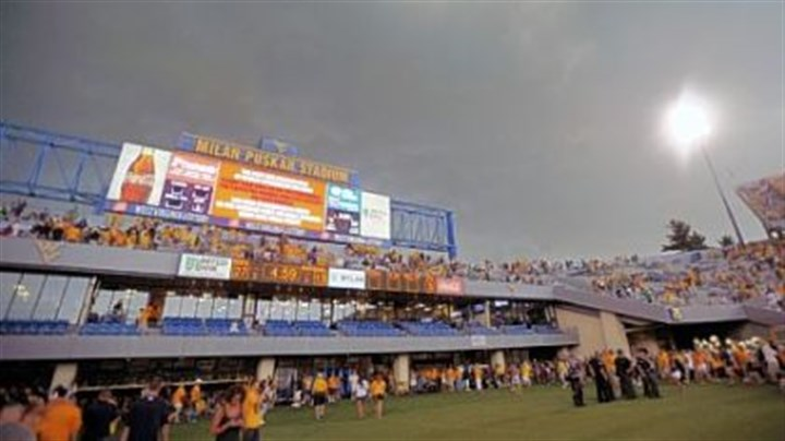 Rain delay Fans exit the stadium during a weather delay at the West Virginia and Marshall NCAA college football game, Sunday, Sept. 4, 2011 in Morgantown, W.Va. Fans were told to leave their seats midway through the third quarter with West Virginia leading 27-13. It marked the fourth stadium to be cleared due to storms that started Saturday in the Midwest.