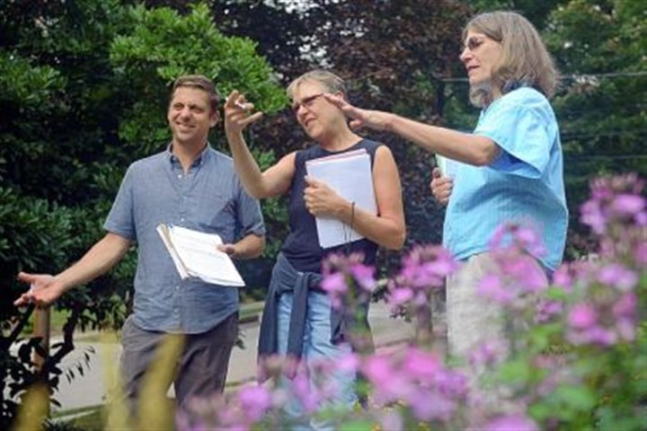 rain garden Judges for the 2013 Rain Garden Contest, left to right, Joel Perkovich, Lynne Weber and Sandy Feather, examine a homeowner's rain garden in Mt. Lebanon last Monday.
