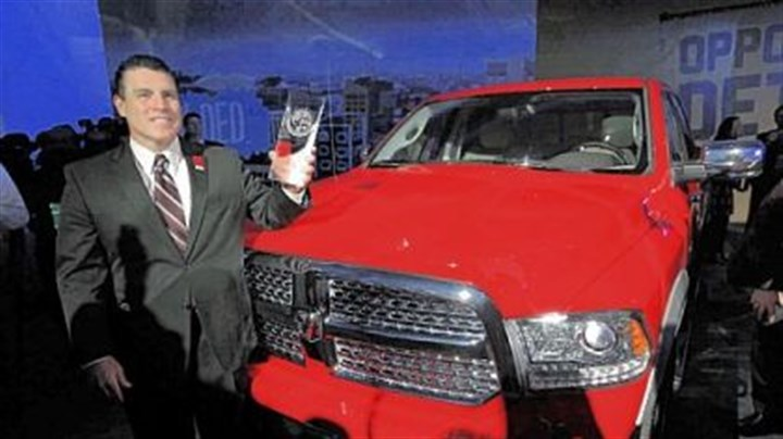 Ram Truck Brand Fred Diaz, president and chief executive officer of Ram Truck Brand, with the Ram 1500 after the vehicle was awarded the North American Truck of the Year at the North American International Auto 