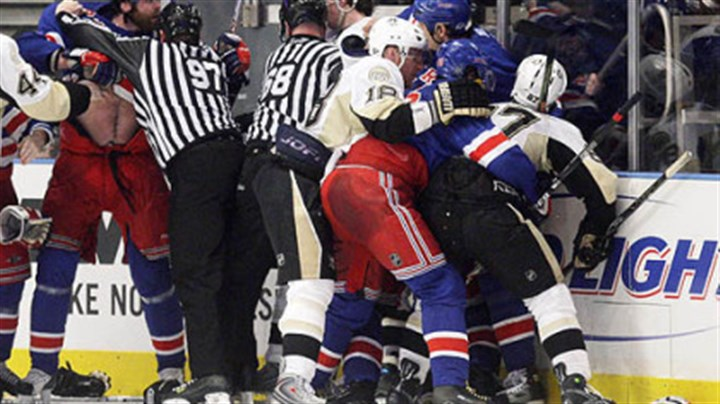 Rangers and Penguins collide New York Rangers' Paul Mara, left, is held back by linesman Jean Morin during a scuffle with the Penguins' Evgeni Malkin after Rangers' Jaromir Jagr scored with 14 seconds left in the third period during Game 4 of an NHL Eastern Conference semifinal hockey playoff series Thursday, in New York. The Rangers won 3-0.