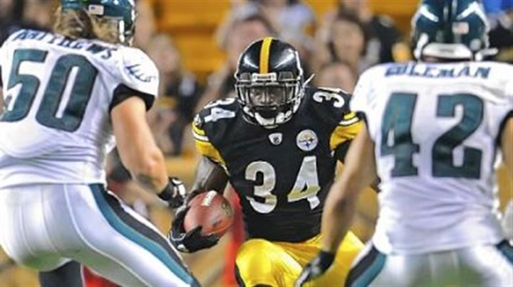 Rashard Mendenhall Rashard Mendenhall eyes two Eagles defenders.