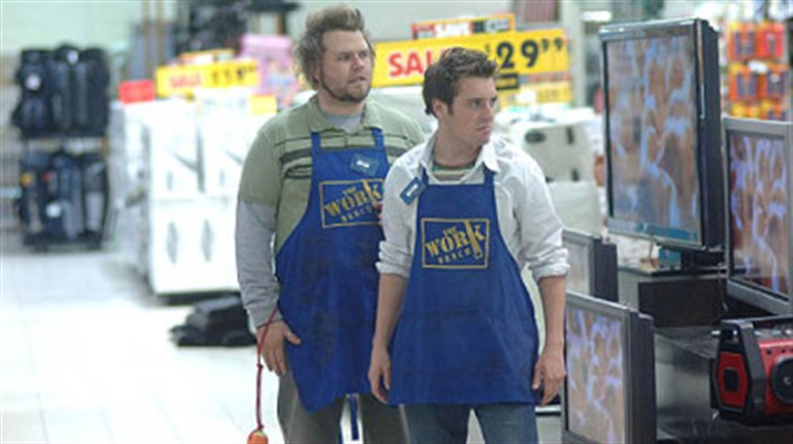 """Reaper""  Bret Harrison, right, and Tyler Labine don Work Bench aprons in ""Reaper."""