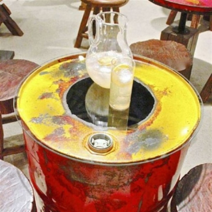 Reclaimed steel drum side table Reclaimed steel drum side table with glass top by Groovystuff.