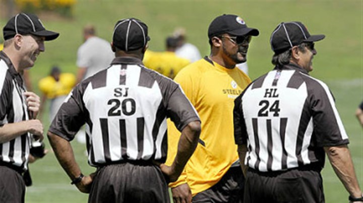 Ref Coach Mike Tomlin talks to NFL referees during training camp Thursday.