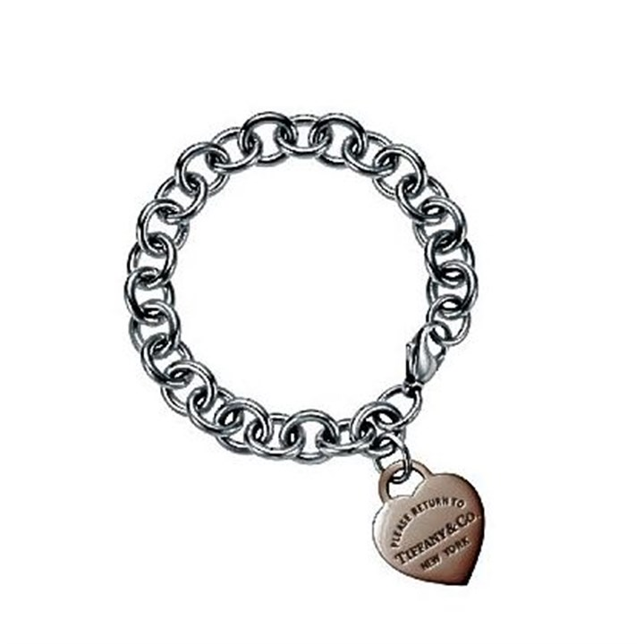 Return to Tiffany heart tag Return to Tiffany heart tag in RUBEDO metal on a sterling silver bracelet chain; $475.