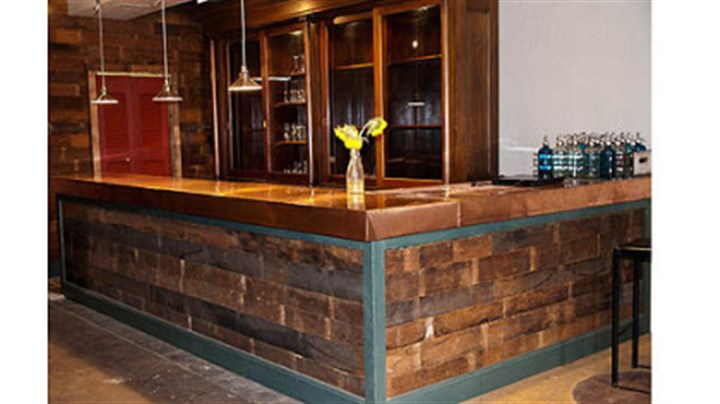Reuse winner E2 restaurant Todd Meyer of Swissvale used salvaged materials in a renovation of E? restaurant in Highland Park. His crew used reclaimed floor boards on the bar front.