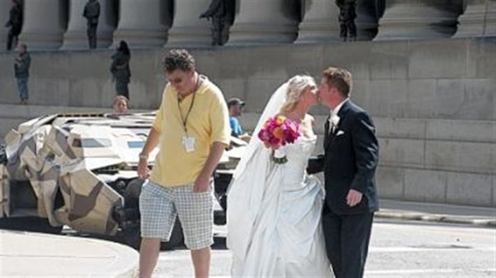 "Rich Walsh and his bride, Michele WPXI sports anchor Rich Walsh and his bride, Michele, share a kiss after getting a close look at the Batmobile (also known at The Tumbler) on the set of ""The Dark Knight Rises"" on Fifth Avenue in Oakland. Mr. and Mrs. Walsh had just finished their wedding ceremony at St. Paul Cathedral."