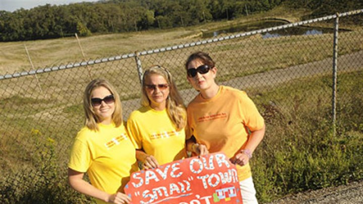 Ridgemont Chicken Hill Caucus members, from left, Kimberly Botticello, Beth Hanis and Denise Zurcher display a sign that signals the group's opposition to a proposed development on Springfield Street in Ridgemont.