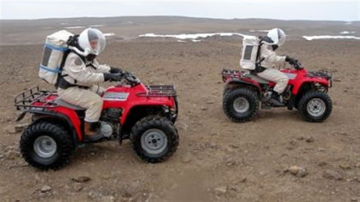 Riding ATVs Kristine Ferrone, right, and Stacy Cusack, another Johnson Space Center employee, ride the all-terrain vehicles after they were repaired.