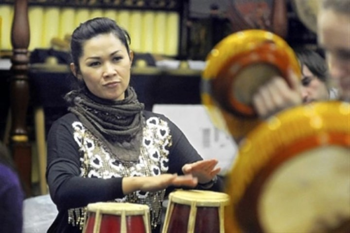 Rika Rafika Rika Rafika, a vocalist from West Java, plays the drums at rehearsal with the University of Pittsburgh Gamelan.