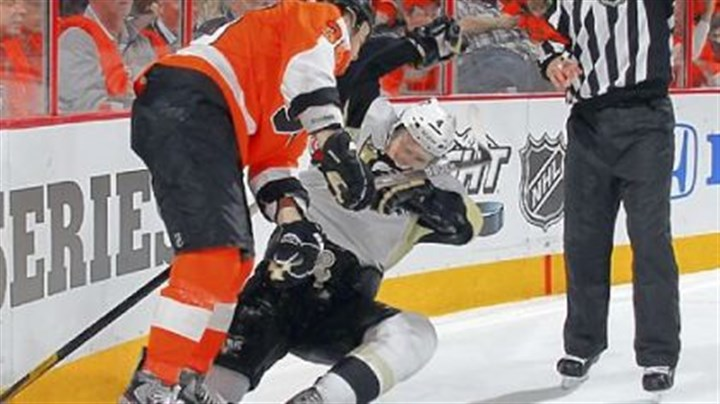 Rinaldo Zac Rinaldo, left, was not suspended for this hit on Zbynek Michalek in the second period Wednesday.