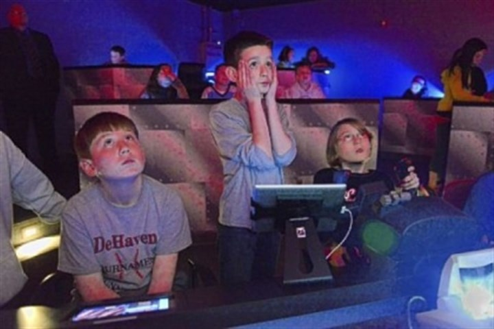 rispoli Shaler Area Elementary School fifth-graders Nick Rispoli, 11, Michael Bly, 11, and Bella James, 10, take a trip Thursday to the site of the sinking of the Lusitania using the Dream Flight Adventures simulator.