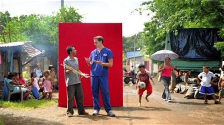 RMU ad In one new Robert Morris TV commercial, nursing student Lee Folk, who has since graduated, is pictured in a Nicarauguan barrio next to a teen from that country. Mr. Folk was in Nicaraugua for a clinical study program in nursing.