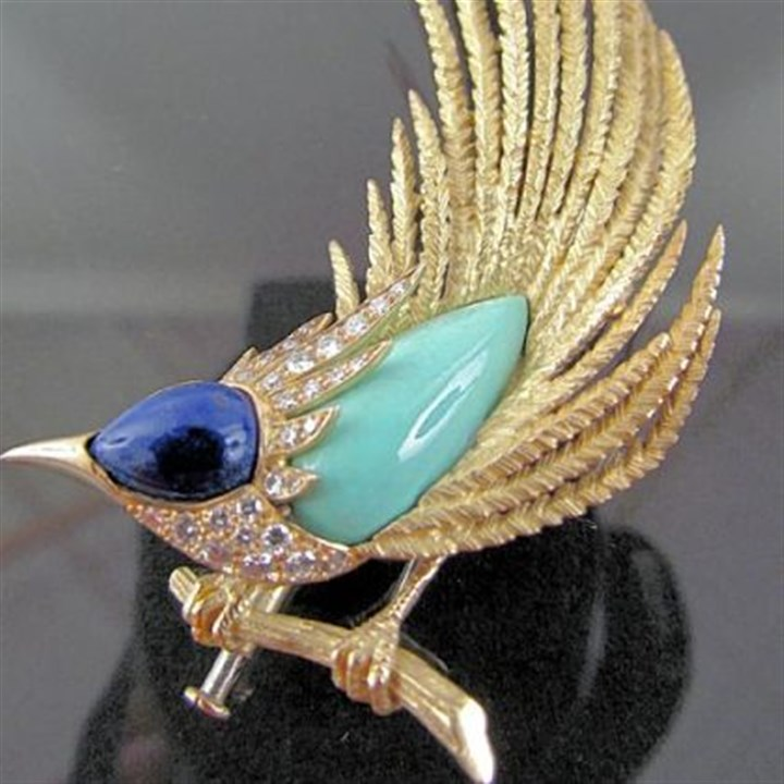Roadrunner pin Roadrunner pin, fashioned in France, is made of 14-karat gold, diamonds, lapis and turquoise. Estimated sale price is between $1,500 and $3,000. It is from the estate of Amelia Neville Shields Guirola to be auctioned at Concept Gallery.