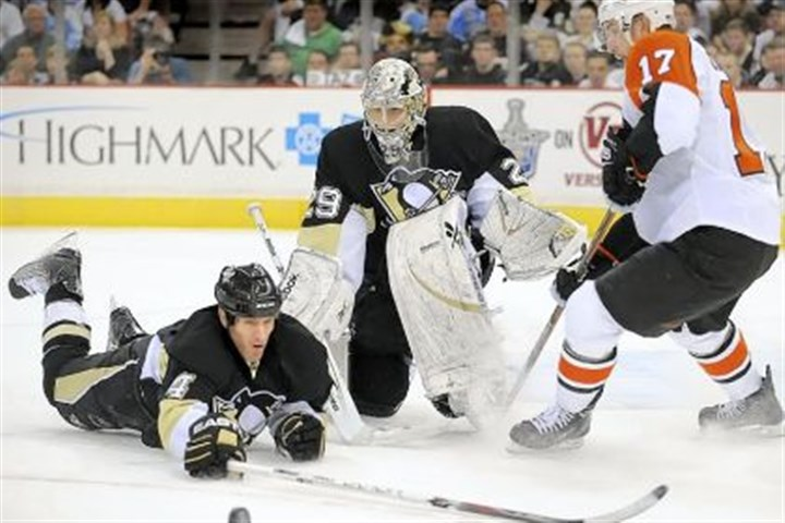 Rob Scuderi Rob Scuderi dives and make save in front of goalie Marc-Andre Fleury against the Flyers in 2009. After four years in Los Angeles, Scuderi is back with the Penguins.