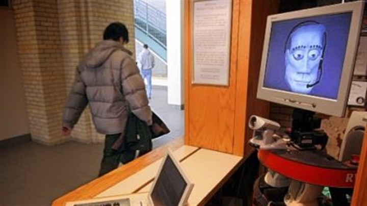 roboceptionist at CMU Tank the roboceptionist greets visitors at Newell-Simon Hall on the CMU campus.