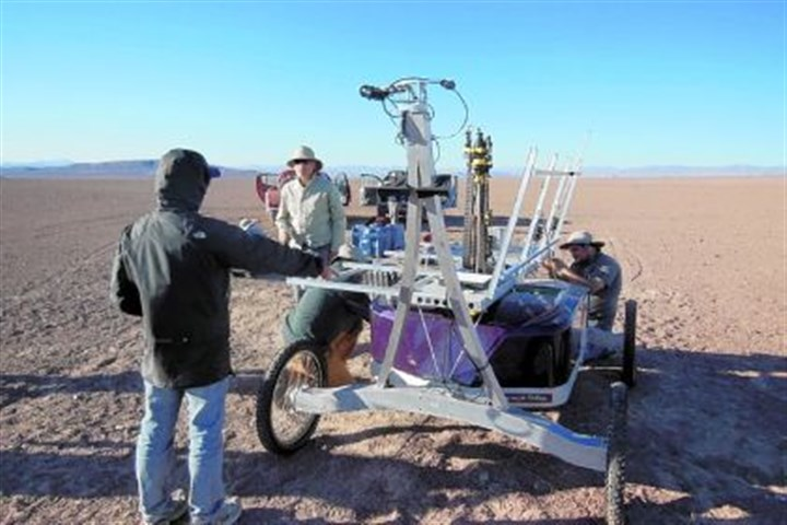 Robot Zoe A team of researchers check robot Zoe after the trip to the Atacama Desert in Chile. It will trek for 30-50 kilometers and drill in the hyper-arid ground for soil samples in preparation for searching for subsurface life on Mars in 2020.