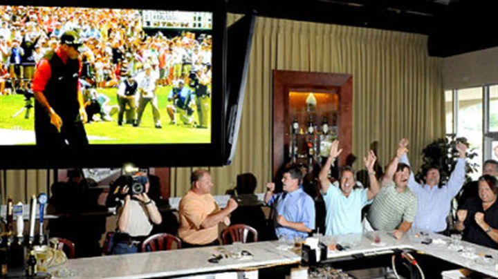 Rocco's friends cheer for him on the 18th hole Friends of Rocco Mediate cheer his par putt on the 18th hole to force a sudden-death hole in his U.S. Open playoff with Tiger Woods at the Torey Pines Golf Course in San Diego. They were watching on TV from Bruschetta's Bar & Grill in Murrysville.
