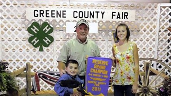 Rod Winters Rod Winters, left, of Energy Corporation of America, with his daughter, Parker, pose at the Greene County Fair after Mr. Winters bought the reserve Grand Champion lamb, seen with owner Hayden Demniak, 10, of Cumberland Township. Other energy companies also made purchases at the fair's 4-H Market Sale.