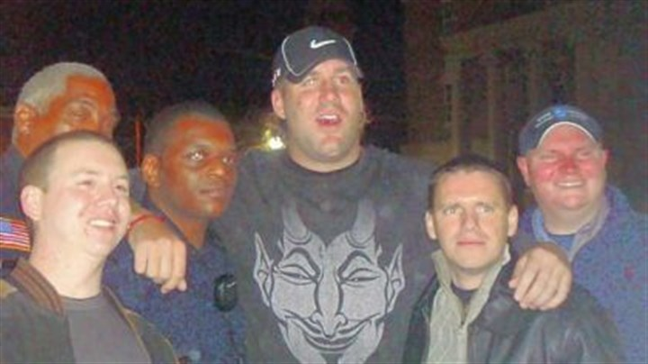 Roethlisberger 1 Steelers quarterback Ben Roethlisberger poses for photos with Milledgeville, Ga., police on the same night a 20-year-old college student accused the NFL star of assaulting her in a local nightclub. Pictured are left to right, Officer Paul Cressman; Lt. Willie Goddard; Sgt. Jerry Blash; Mr. Roethlisberger; Detective Everett January; and Nick Reonas, a public safety officer with Georgia College & State University.