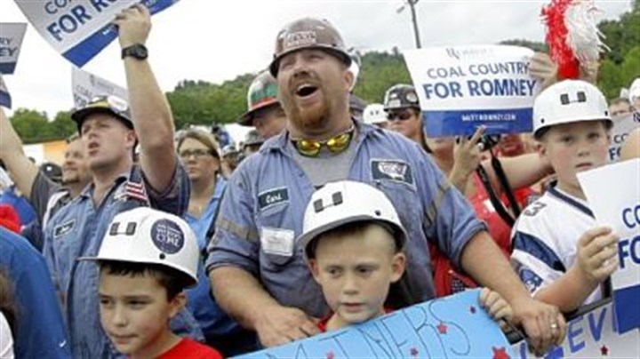 Romney campaign in Ohio A coal miner cheers as Republican presidential candidate Mitt Romney campaigns at the American Energy Corporation Aug. 14 in Beallsville, Ohio.