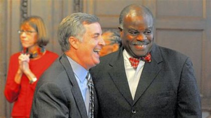 Roosevelt, Bentley Pittsburgh Public Schools Superintendent Mark Roosevelt, left, shares a laugh with school board member Mark Bentley Sr., after announcing his resignation.