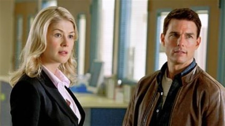 "Rosamund Pike and Tom Cruise Rosamund Pike portrays a defense attorney and Tom Cruise is Reacher in ""Jack Reacher."""