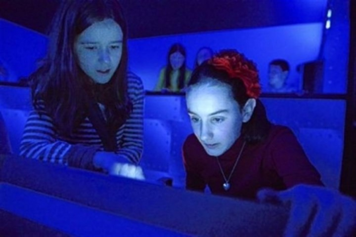 rosso Fifth-graders Anna Rosso, 10, and Mary Flint, 10, use the simulator.
