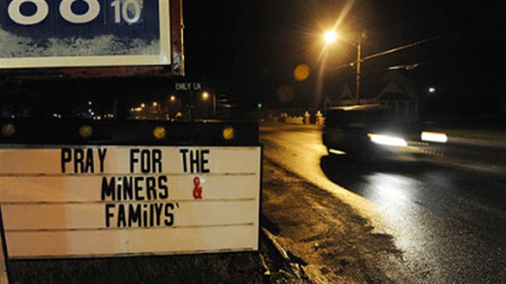 Route 3 A sign outside of a gas station along Route 3 asks passersby to pray for the families of the miners caught in Massey Energy's Upper Big Branch mine explosion there killed at least 25 people, Monday.