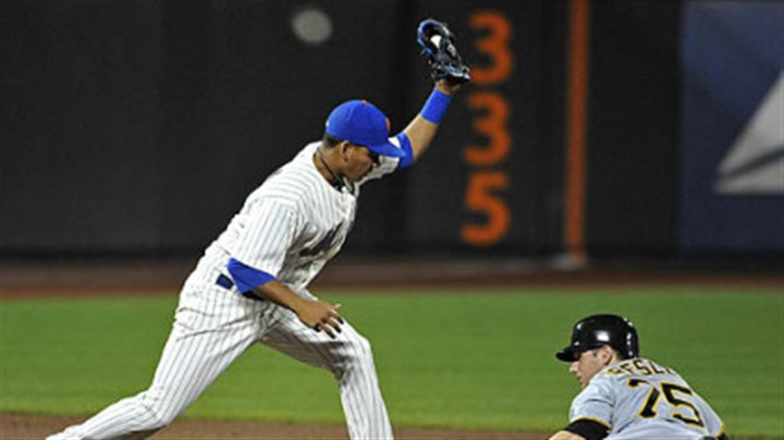 Ruben Tejada and Alex Presley Mets second baseman Ruben Tejada holds up his glove after tagging out the Pirates' Alex Presley on an attempted steal of second in the ninth inning.
