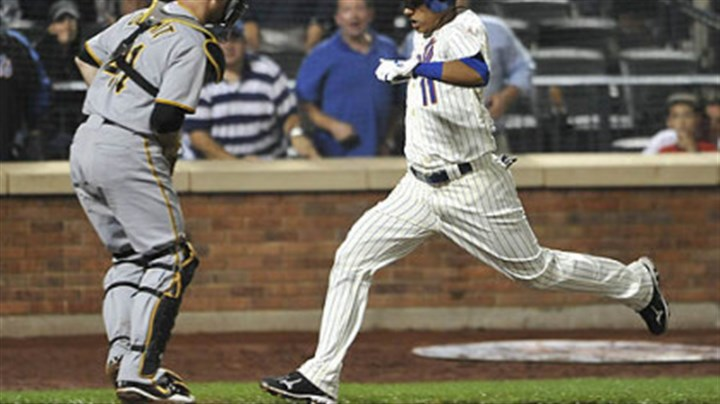 Ruben Tejada and Ryan Doumit The Mets' Ruben Tejada scores the winning run in front of Pirates catcher Ryan Doumit on a single by Nick Evans in the 10th inning.