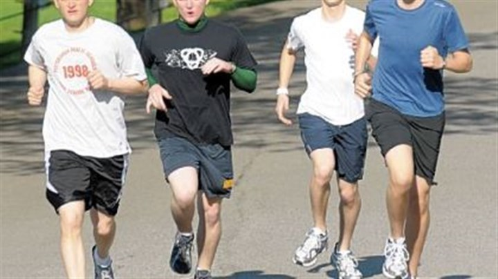 Runners Seminarians, from left, William Wuenschel, Benjamin Cahill, Anthony Sciarappa and Patrick Caruso will be running in Sunday's Pittsburgh Marathon to raise money for people who need to pay college loans before joining religious orders and taking vows of poverty.