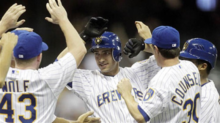Ryan Braun The Brewers' Ryan Braun is mobbed by teammates after getting the game-winning hit during the 10th inning.
