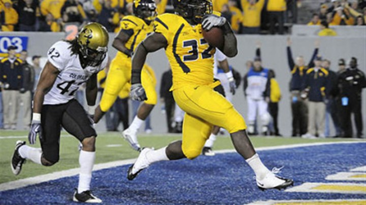 Ryan Clark and Benjamin Burney West Virginia fullback Ryan Clarke crosses into the end zone past Colorado cornerback Benjamin Burney during the fourth quarter of last night's game at Mountaineer Field in Morgantown, W.Va.