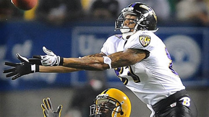 Ryan Clark breaks up pass Ryan Clark breaks up pass intended for the Ravens' Demetrius Williams last night.