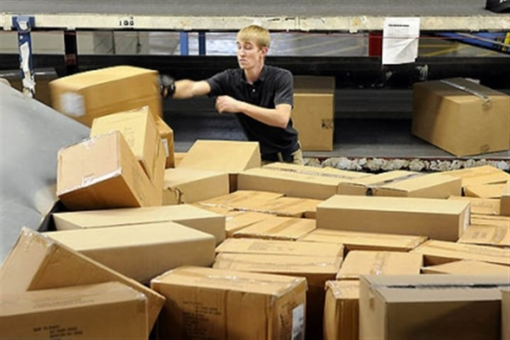 Ryan Craig Ryan Craig, with FedEx Ground, sorts boxes at the Neville Island facility.
