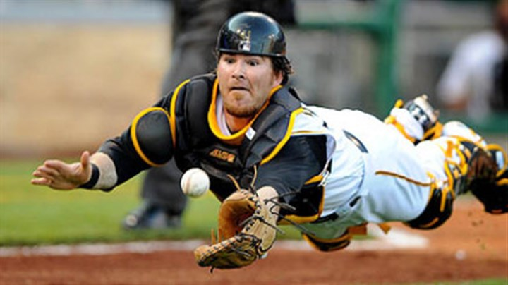 Ryan Doumit The Pirates' catcher Ryan Doumit makes a diving attempt on bunted ball by the Diamondbacks' pitcher Brandon Webb in the second inning tonight.