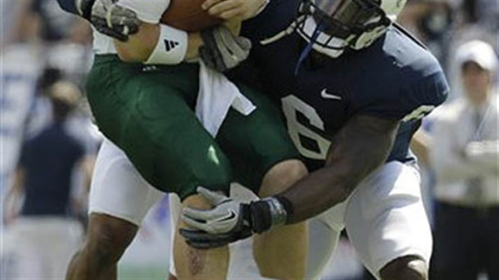 Sack Penn State linebackers Gerald Hodges and Khairi Fortt, rear, tackle Eastern Michigan quarterback Alex Gillett during the second quarter of today's game in State College.