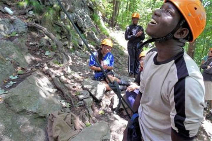 Salomon Andre Salomon Andre looks up after making it to the top of the rocky cliff in Worthington State Forest during Philadelphia's Summer Search program with Outward Bound in the Delaware Water Gap near Columbia, N.J., earlier this month.