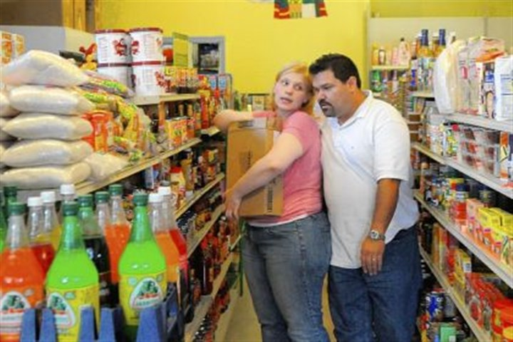 Samantha Franco and Saul Franco Jimenez Samantha Franco and Saul Franco Jimenez, owners of Tienda La Jimenez, a store specializing in Latino products in Beechview, stock shelves during a lull in business.