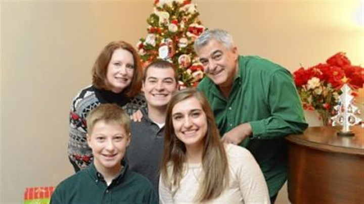 Santa breakfast The Albanese family, from left, Barb, 49, Luciano, 12, Lorenzo, 20, Giovanna, 17, and Dave, 53, at their home in New Brighton. Dave Albanese, who spends most of the year teaching in Doha, Qatar, returns to Pittsburgh each year for a special Christmas breakfast.