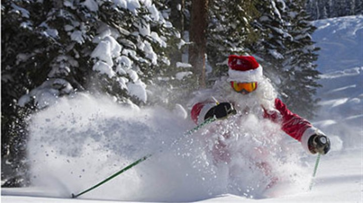 Santa skiing Gregory A. Gull Jr., dressed as Santa Claus, skis on Thursday in fresh snow in Crested Butte, Colo. Light snow began falling this morning in Pittsburgh on the first day of winter.