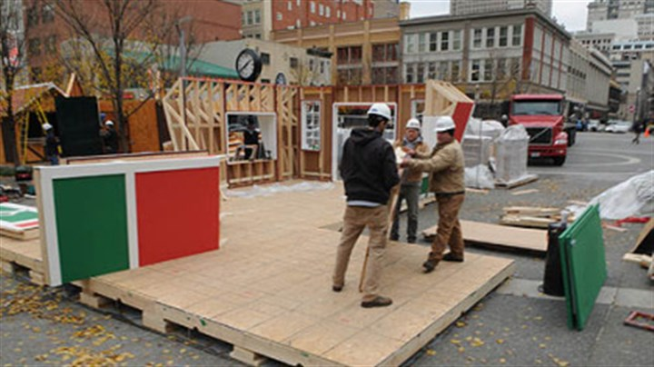 "santas house construx Pre-assembled sections are moved into place for the assembly of ""Santa's House"" in Market Square."