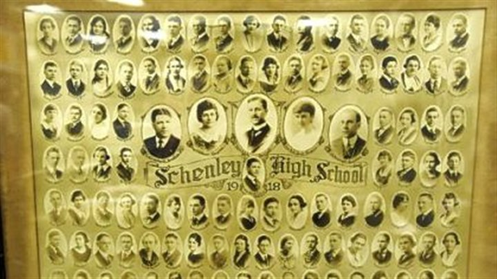 Schenley's first class A framed photograph of the first graduating class of Schenley High School in 1918 is part of senior James Hill's collection of memorabilia.