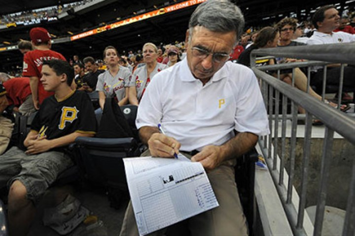Scorecards John Dioguardi, of Beaver, keeps score of the Pirates game Wednesday night against the St. Louis Cardinals. In 30 years of holding season tickets, Mr. Dioguardi has always kept track of the score.