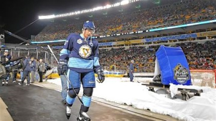 Scoreless Sidney Crosby heads to locker room after losing to the Capitals in the Winter Classic at Heinz Field last night. Crosby was held scoreless for a second consecutive game.